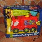 Zenélő-világító tűzoltó autó